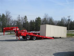 Sliding axle container trailer